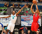 SIOUX FALLS, SD - MARCH 5:  Damian Saunders #18 from the Sioux Falls Skyforce stretches out for a block attempt on Justin Harper #24 from the Idaho Stampede in the first half of their game Tuesday night at the Sioux Falls Arena. (Photo by Dave Eggen/Inertia)