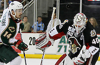 Houston Aeros' Jon DiSalvatore, left, closes in on the puck to score on Binghamton Senators' goaltender Robin Lehner during the second period of game six of the AHL Calder Cup Finals, Tuesday, June 7, 2011, in Houston. Binghamton won 3-2 to take the championship. (Darren Abate/pressphotointl.com/AHL)