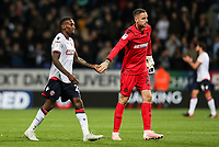 Bolton Wanderers' Lloyd Dyer with team mate Remi Matthews at the end of the match<br /> <br /> Photographer Andrew Kearns/CameraSport<br /> <br /> The EFL Sky Bet Championship - Bolton Wanderers v Blackburn Rovers - Saturday 6th October 2018 - University of Bolton Stadium - Bolton<br /> <br /> World Copyright © 2018 CameraSport. All rights reserved. 43 Linden Ave. Countesthorpe. Leicester. England. LE8 5PG - Tel: +44 (0) 116 277 4147 - admin@camerasport.com - www.camerasport.com