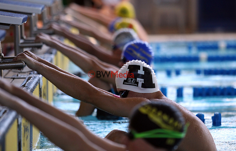 Swimmers wait on the starting blocks during the Swimming New Zealand Division II Championships, Moana Pool, Dunedin, Friday 20 March 2015. Photo: Rob Jefferies/www.bwmedia.co.nz
