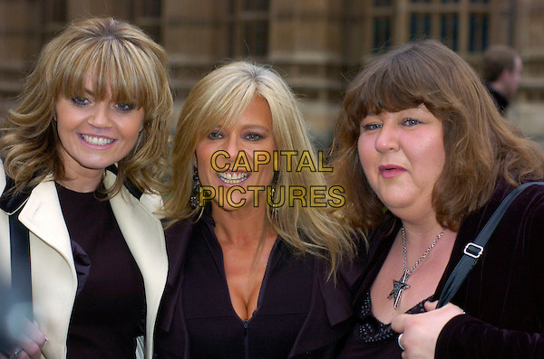 DANIELLA WESTBROOK, SAMANTHA FOX & CHERYL FERGISON.at The Woman's Own Children Of Courage Award, Westminster Abbey, London, England, UK, .December 10th 2009..portrait headshot Sam black ruffle folded collar jacket cleavage fringe silver necklace cream smiling tanned sun tan skin star .CAP/DYL.©Dylan/Capital Pictures.