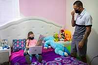 HERMOSILLO, MEXICO - MAY 08: Oscar Rai Villa of Cimarrones De Sonora accompanies and helps his 8-year-old daughter Abril Maribel while she does her homework in the middle of the Coronavirus pandemic on May 8, 2020 in Hermosillo, Mexico. Due to the Coronavirus crisis the Liga MX has announced the cancellation of the Ascenso MX 2019-2020 season and to temporarily suspend promotions and relegations for the next six seasons. (Photo by Luis Gutierrez/Norte Photo/Getty Images)