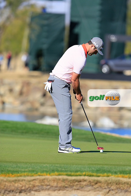 Jon Rahm (ESP) putts on the 17th green during Saturday's Round 3 of the 2017 CareerBuilder Challenge held at PGA West, La Quinta, Palm Springs, California, USA.<br /> 21st January 2017.<br /> Picture: Eoin Clarke | Golffile<br /> <br /> <br /> All photos usage must carry mandatory copyright credit (&copy; Golffile | Eoin Clarke)