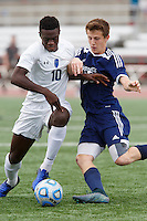 Mishawaka Marian's Jordan Morris (10) and Providence's Alex Rogers (25) play the ball during the IHSAA Class A Boys Soccer State Championship Game on Saturday, Oct. 29, 2016, at Carroll Stadium in Indianapolis. Marian won 4-0. Special to the Tribune/JAMES BROSHER
