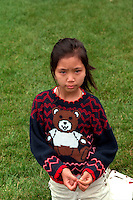 Asian girl age 7 looking serious at Vietnam Wall on Memorial Day. St Paul Minnesota USA
