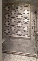 This custom shower features Pembroke, a handmade mosaic shown in honed Nero Marquina, Bardiglio, Thassos and Carrara, a part of the Silk Road Collection by Sara Baldwin for New Ravenna.<br /> <br /> For pricing samples and design help, click here: http://www.newravenna.com/showrooms/