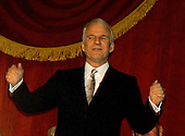 Washington, DC - October 23, 2005 -- Steve Martin acknowledges the applause as he arrives in the hall to be awarded the eighth annual Mark Twain Prize for American Humor at the John F. Kennedy Center for the Performing Arts in Washington on October 23, 2005.Credit: Ron Sachs / CNP