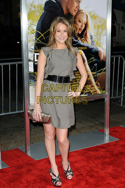 "ALEXA VEGA .Arriving at the world premiere of ""Dear John"" at Grauman's Chinese Theatre in Hollywood, California, USA, .February 1st 2010.  .arrivals full length dress black waist belt hand on hip sandals clutch bag ruffles ruffle gold silver grey gray dress .CAP/ROT.©Lee Roth/Capital Pictures"
