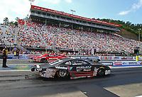 Jun 21, 2015; Bristol, TN, USA; NHRA pro stock driver Shane Gray (near lane) races alongside Erica Enders-Stevens during the Thunder Valley Nationals at Bristol Dragway. Mandatory Credit: Mark J. Rebilas-