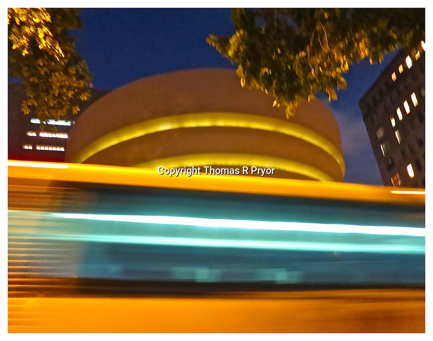 NEW YORK, NY - JUNE 26: 5th Ave bus passing the Guggenheim museum at night next to Central Park in New York, New York on June 26, 2013. Photo Credit: Thomas R Pryor