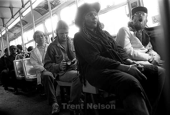 People on bus. Brent Stevens with camera on bus<br />
