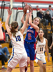 WINSTED,  CT-021919JS20-  Nonnewaug's Ashley Hennessey (5) pulls down a puts up a shot over Housatonic's Caroline Hurlburt (10) during their Berkshire League semi-final game Tuesday at Northwestern Regional High School in Winsted. <br /> Jim Shannon Republican American