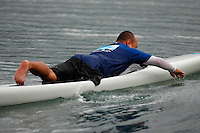 Carlito Butalip paddles a surfboard on Mission Bay during an event sponsored by the Challenged Athletes Foundation on Saturday, January 24th 2009.  The participants had the opportunity to try several different paddle sports. The Challenged Athletes Foundation established the Operation Rebound fund to provide sports opportunities and support for troops, veterans and first responders who have suffered permanent physical injuries in the line of duty.