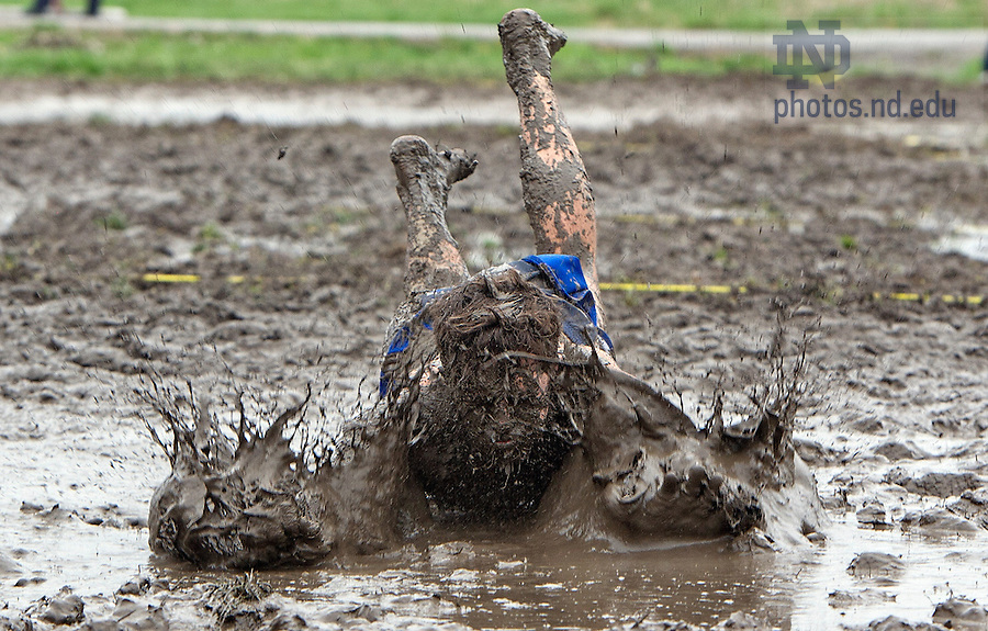 April 28, 2013;  Mechanical engineer student, Jonathan Cernanec, takes a final dive in the mud during Muddy Sunday's charity event. Photo by Barbara Johnston/University of Notre Dame
