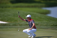 Gainesville, VA - August 1, 2015: Rickie Fowler readies for his putt on the 13th hole of the Quicken Loans National at the Robert Trent Jones Golf Club in Gainesville, VA, August 1, 2015.  Fowler completed the round at -3, placing him at -13 for the tournament, one stroke off the lead.  (Photo by Don Baxter/Media Images International)