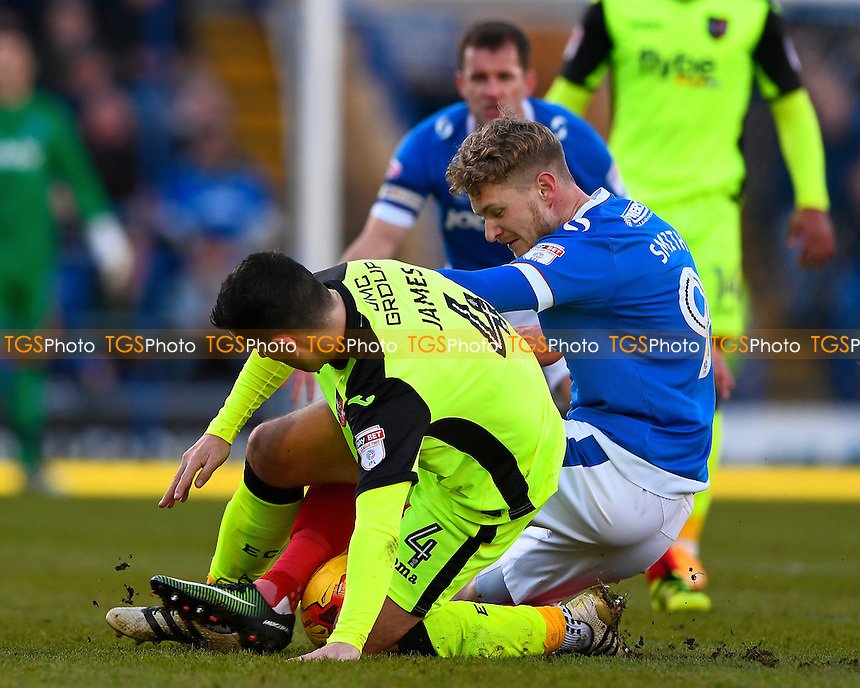 Michael Smith of Portsmouth right tangles with Lloyd James of Exeter City during Portsmouth vs Exeter City, Sky Bet EFL League 2 Football at Fratton Park on 28th January 2017