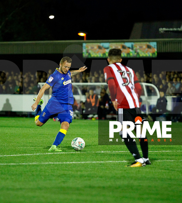 AFC Wimbledon's Dean Parrett lines up a shot during the Carabao Cup match between AFC Wimbledon and Brentford at the Cherry Red Records Stadium, Kingston, England on 8 August 2017. Photo by Carlton Myrie.