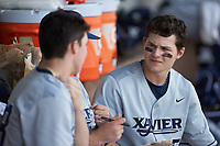 Nate Soria (5) of the Xavier Musketeers sits in the dugout against the Penn State Nittany Lions at Coleman Field at the USA Baseball National Training Center on February 25, 2017 in Cary, North Carolina. The Musketeers defeated the Nittany Lions 10-4 in game one of a double header. (Brian Westerholt/Four Seam Images)