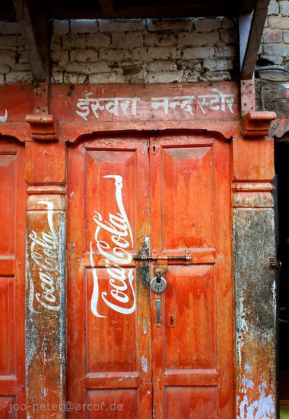 shop door in Bhaktapur, Nepal, door painted with Hindu letters and red coca-cola sign