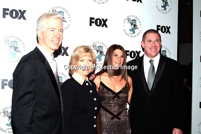 Gray Davis and wife Sharon Davis, Barbara Grushow and Sandy Grushow<br />The H.E.L.P. Group&rsquo;s Teddy Bear Ball, honoring Sandy Grushow and his wife Barbara<br />Beverly Hilton Hotel<br />Beverly Hills, CA, USA  <br />Saturday, December 6, 2003  <br />Photo By Celebrityvibe.com/Photovibe.com