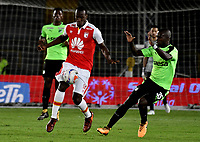 BOGOTA - COLOMBIA - 20 - 01 - 2018: Baldomero Perlaza (Izq.) player de Independiente Santa Fe disputa el balón con Kevin Balanta (Der.) jugador de Deportivo Cali, durante partido entre Independiente Santa Fe y Deportivo Cali, por el Torneo Fox Sports 2018, jugado en el estadio Nemesio Camacho El Campin de la ciudad de Bogota. / Baldomero Perlaza (L) player of Independiente Santa Fe vies for the ball with Kevin Balanta (R) player of Deportivo Cali, during a match between Independiente Santa Fe y Deportivo Cali, for the Fox Sports Tournament 2018, played at the Nemesio Camacho El Campin stadium in the city of Bogota. Photo: VizzorImage / Luis Ramirez / Staff.