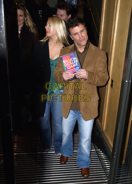 """CRAIG PHILLIPS (BIG BROTHER).""""Billion Dollar Game"""" Book Launch Party, BAFTA, London, April 6th 2005..full length funny face leaving.Ref: SW.www.capitalpictures.com.sales@capitalpictures.com.©Stephen Walters/Capital Pictures."""