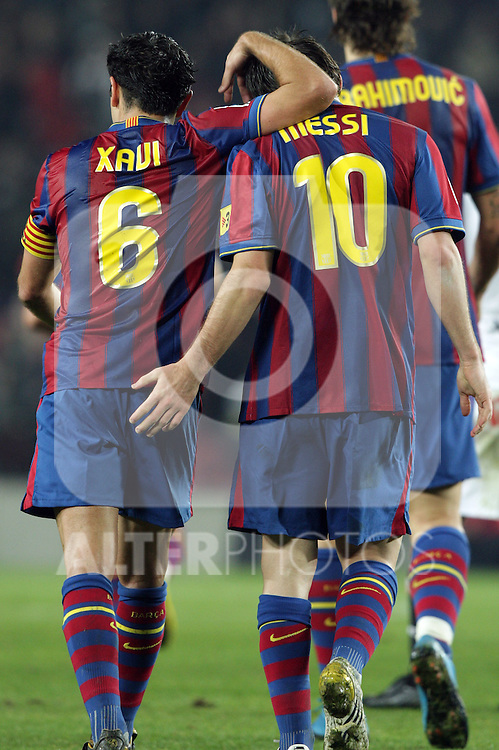 Football Season 2009-2010. Barcelona players Xavi Hernandez and  Lionel Messi celebrating a goal during their spanish liga soccer match at Camp Nou stadium in Barcelona. January 16, 2010.