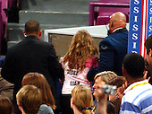 New York, NY - September 1, 2004 -- An unidentified young woman is led away by security personnel during an impromptu protest on the floor during the remarks of White House Chief of Staff Andrew Card at the 2004 Republican Youth Convention in Madison Square Garden in New York, New York on Wednesday, September 1, 2004. .Credit: Ron Sachs / CNP                                                              .(RESTRICTION: No New York Metro or other Newspapers within a 75 mile radius of New York City)