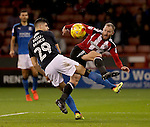 Matt Done of Sheffield United tussles with Raphael Rossi Branco of Swindon Town during the English Football League One match at Bramall Lane, Sheffield. Picture date: December 10th, 2016. Pic Jamie Tyerman/Sportimage
