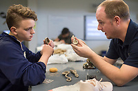NWA Democrat-Gazette/CHARLIE KAIJO Ceramics teacher Hunter Alexander (from right) helps Parker Judd, 15, with a project, Thursday, April 12, 2018 at Bentonville West High School in Centerton.<br />