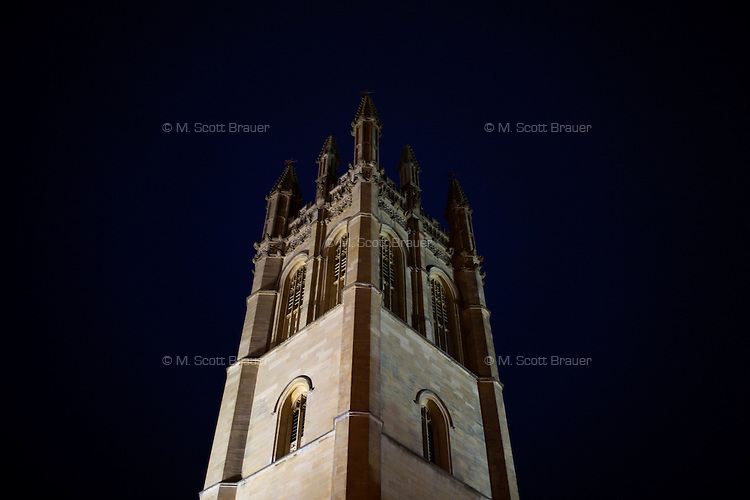 The bell tower of Magdalen College at the University of Oxford reaches into the night sky in Oxford, England.
