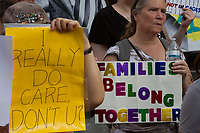 "People holding signs reading ""I really do care"" take part in the families Belong Together Rally to protest the policy of separating migrant families as they cross the Southern US border carried out by the Administration of President Donald Trump in Tokyo's iconic Hachiko Square in Shibuya, Japan. Saturday June 30th 2018. Around thirty people from Democrats Abroad Japan, along with Japanese and other foreigners, took part in the demo which was part of an international day of action that saw more than 625 protests worldwide."