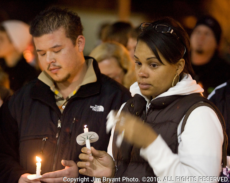 Stephanie James, right, wipes away a tear during a light prayer vigil at the Champion's Centre in Tacoma WA., for family members, friends and law enforcement officers for four Lakewood Police officers killed at a Lakewood coffee shop on Sunday, Nov. 29, 2009.  At about 8:00 a.m. Sunday morning, a gunman walked into the Forza Coffee shop and while the four police officers were having coffee before their shift started, he opened fire, killing all four law enforcement officers. James, who's husband is also a Lakewood poice officer knew the police officers killed. Jim Bryant Photo. ©2010. ALL RIGHTS RESERVED.