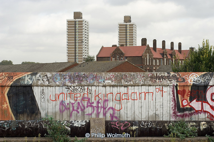Graffiti and tower blocks seen from Green Way, a high level walkway through the planned site of the 2012 Olympic Games in the Lower Lea Valley, east London.