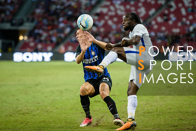 Chelsea Midfielder Victor Moses (R) battles for the ball with FC Internazionale Forward Ivan Perisic (L) during the International Champions Cup 2017 match between FC Internazionale and Chelsea FC on July 29, 2017 in Singapore. Photo by Weixiang Lim / Power Sport Images