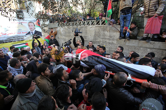 Mourners carry the body of Palestinian Baseem Salah, 38-year-old during his funeral in the West Bank city of Nablus on Dec. 30, 2015. Salah was killed Nov. 30 after an attack left an Israeli police officer wounded in Jerusalem's Old City. Since a wave of unrest swept the occupied Palestinian territory at the beginning of October, Israel has routinely held the bodies of Palestinians it says were attempting to attack Israelis. Photo by Nedal Eshtayah