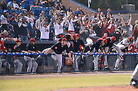 Hickory Crawdads celebration spills out of the dugout after game 3 of the South Atlantic League Championship Series between the Asheville Tourists and the Hickory Crawdads on September 17, 2015 in Asheville, North Carolina. The Crawdads defeated the Tourists 5-1 to win the championship. (Tony Farlow/Four Seam Images)