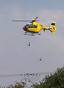 15/07/14<br /> <br /> On a day of electrical storms and power cuts, a Western Power Distribution helicopter inspects high voltage cables near Uttoxeter, Staffordshire.<br /> <br /> All Rights Reserved: F Stop Press Ltd. +44(0)1335 300098   www.fstoppress.com.
