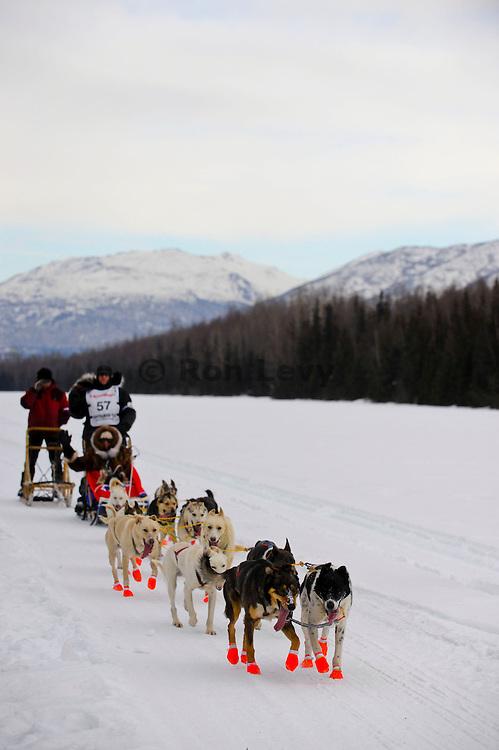 Iditarod musher James Bardoner along Campbell Creek airstrip in Anchorage, Alaska at start of Iditarod 2011.