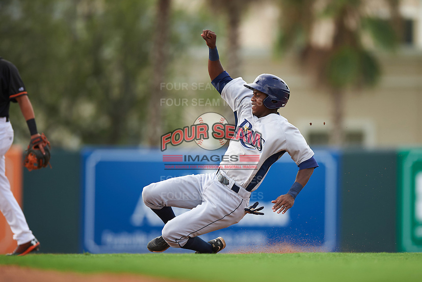 GCL Rays outfielder Miguel Hernandez (14) slides into second during the first game of a doubleheader against the GCL Orioles on August 1, 2015 at the Ed Smith Stadium in Sarasota, Florida.  GCL Orioles defeated the GCL Rays 2-0.  (Mike Janes/Four Seam Images)