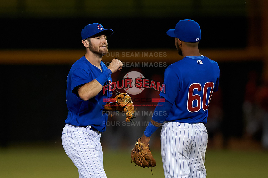 AZL Cubs 1 Zac Taylor (83) bumps fists with Oswaldo Pina (60) after an Arizona League game against the AZL Angels on June 24, 2019 at Sloan Park in Mesa, Arizona. AZL Cubs 1 defeated the AZL Angels 12-0. (Zachary Lucy / Four Seam Images)