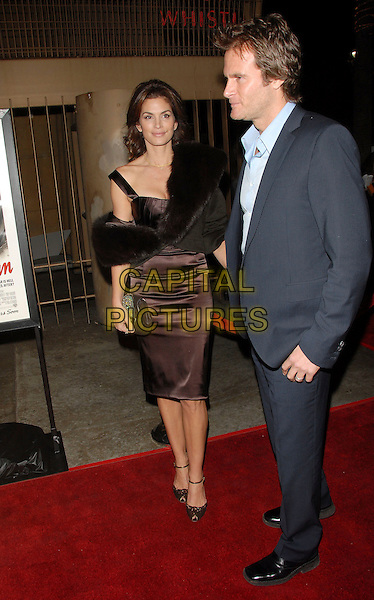 CINDY CRAWFORD & RANDY GERBER.attends The Warner Brothers Pictures Los Angeles Premiere of The Good German held at The Egyptian Theatre in Hollywood, California, USA, December 4th 2006..full length rande married husband wife brown dress black fur wrap.CAP/DVS.©Debbie VanStory/Capital Pictures