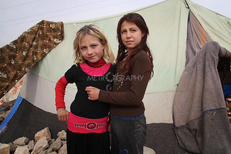 ARBAT, IRAQ: Sheraz Assad, 8, and Fryal Assad, 9, from Derzor, Syria, are pictured in a refugee camp in Arbat, Iraq. ..The semi-autonomous region of Iraqi Kurdistan has accepted refugees from the conflict in Syria into several camps. Arbat lies near Sulaimaniyah in northeastern Iraq, approximately 500 kilometres from the Syrian border...Photo by Besaran Tofiq/Metrography
