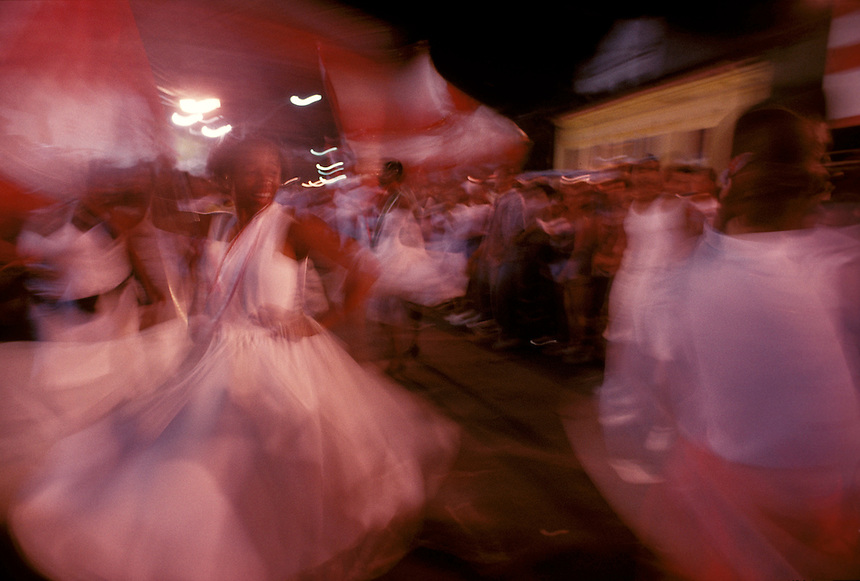 A porta bandeira, or flag bearer, of Rio's Acadêmicos do Salgueiro samba school spins and twists her way through the crowds dancing to the group's chosen theme samba for the year.