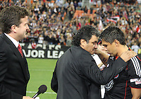 Marco Etcheverry with Jaime watched over by Dave Johnson during festivities surrounding the final appearance of Jaime Moreno in a D.C. United uniform, at RFK Stadium, in Washington D.C. on October 23, 2010. Toronto won 3-2.