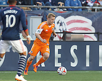 Houston Dynamo midfielder Andrew Driver (20) controls the ball. In a Major League Soccer (MLS) match, the New England Revolution (blue/white) defeated Houston Dynamo (orange), 2-0, at Gillette Stadium on April 12, 2014.