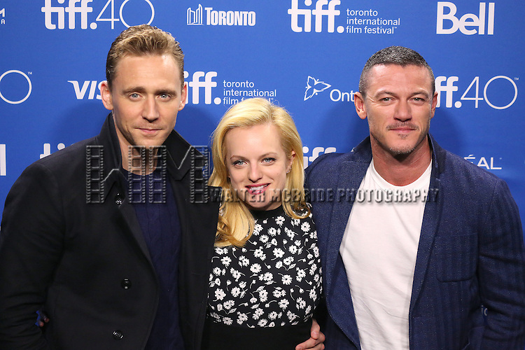 Tom Hiddleston, Elisabeth Moss and Luke Evans attends the 'High-Rise' photo call during the 2015 Toronto International Film Festival at Roy Thomson Hall on September 14, 2015 in Toronto, Canada.