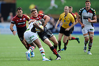 Owen Farrell of Saracens wraps up Ugo Monye of Harlequins during the Aviva Premiership semi final match between Saracens and Harlequins at Allianz Park on Saturday 17th May 2014 (Photo by Rob Munro)