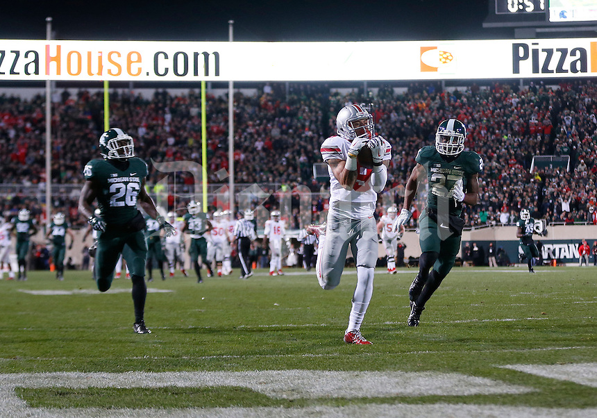 Ohio State Buckeyes wide receiver Devin Smith (9) catches a touchdown pass from Ohio State Buckeyes quarterback J.T. Barrett (16) for the go ahead score in the second quarter of the college football game between the Ohio State Buckeyes and the Michigan State Spartans at Spartan Stadium in East Lansing, Saturday night, November 8, 2014. As of half time the Ohio State Buckeyes led the Michigan State Spartans 28 - 21. (The Columbus Dispatch / Eamon Queeney)