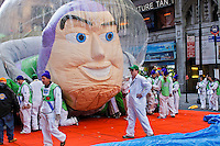 People end the annual Thanksgiving day parade with a Buzz's balloon in New York, November 22, 2012. . Photo by Eduardo Munoz Alvarez / VIEW.